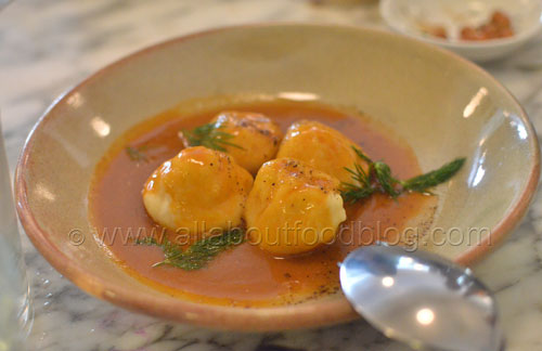 Ricotta gnudi with lobster sauce