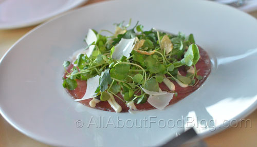 Beef Carpaccio, anchovy mayonnaise, black garlic, capers, parmesan, herbs and garlic chips - $19
