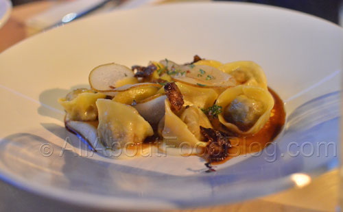 Roast duck ravioli, parsnip puree, pickled pear and crackling - $24