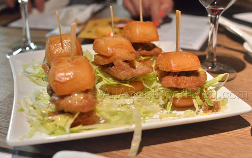 Macanese style mini burger filled with pork fillet, pork floss, lettuce and a sweet chilli mayo dressing