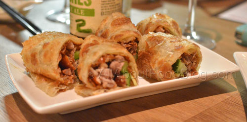 Shredded peking duck with cucumber, hoisin sauce rolled inside a fluffy Chinese roti