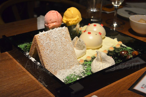 "Signature ""Piggy Face"" sesame bun and ""Totoro"" marshmallow arranged in an edible garden setting, beautifully presented and served with ice cream."