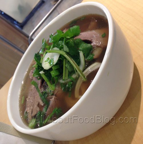 Pho topped with cooked beef - $14