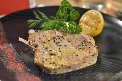 Sesame coated tuna steak with steamed vegetables