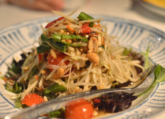 Som Dtum – thai-bpu - $14.00 – Green papaya salad with peanuts and dried shrimps with the addition of pickled crab