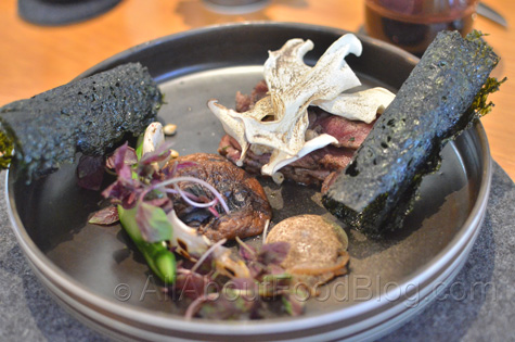 Robata grilled raw beef, pickled greens, shiitake mushrooms, puffed jobs tears - $33