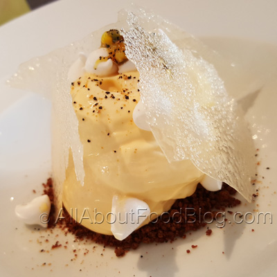 Aerated passionfruit, roasted nougatine, passionfruit ice cream - $18